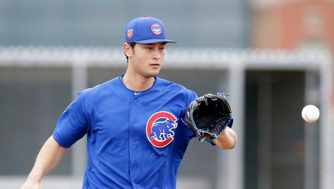 Feb 14, 2018; Mesa, AZ, USA; Chicago Cubs pitcher Yu Darvish (11) covers first base during drills at Sloan Park.