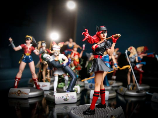 """A figure of Batwoman stands out from other figures designed by Des Moines artist and illustrator Anthony """"Ant"""" Lucia. Lucia has been illustrating DC Comics characters for the DC Bombshells series from his studio on Grand Avenue."""