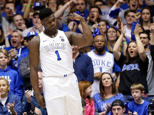 Zion Williamson celebrates after a basket against Virginia. WIlliamson will lead the Blue Devils against Louisville on Tuesday.