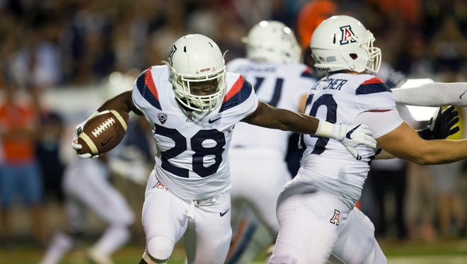 Sep 15, 2017: Arizona Wildcats running back Nick Wilson (28) runs the ball against the UTEP Miners defense during the first quarter at the Sun Bowl.