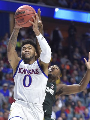 Kansas' Frank Mason (0) drives for a bucket against Michigan State during the second round of the NCAA Tournament in March 2017, at the BOK Center in Tulsa, Okla..