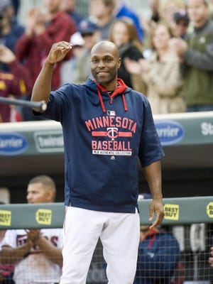 Minnesota Twins right fielder Torii Hunter (48) salutes the fans during a video of his season accomplishments during the seventh-inning stretch against the Kansas City Royals at Target Field on Sunday.