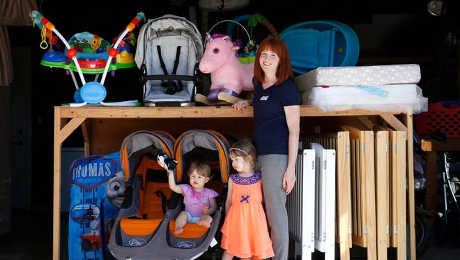 "Babierge ""independent trusted partner"" Kristin Ross is photographed with rental items warehoused in her garage."