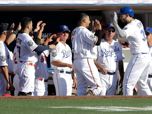 American League's Eric Hosmer, of the Kansas City Royals, right, is greeted by teammates after hitting a home run during the second inning of the MLB baseball All-Star Game, Tuesday, July 12, 2016, in San Diego. (AP Photo/Jae C. Hong)