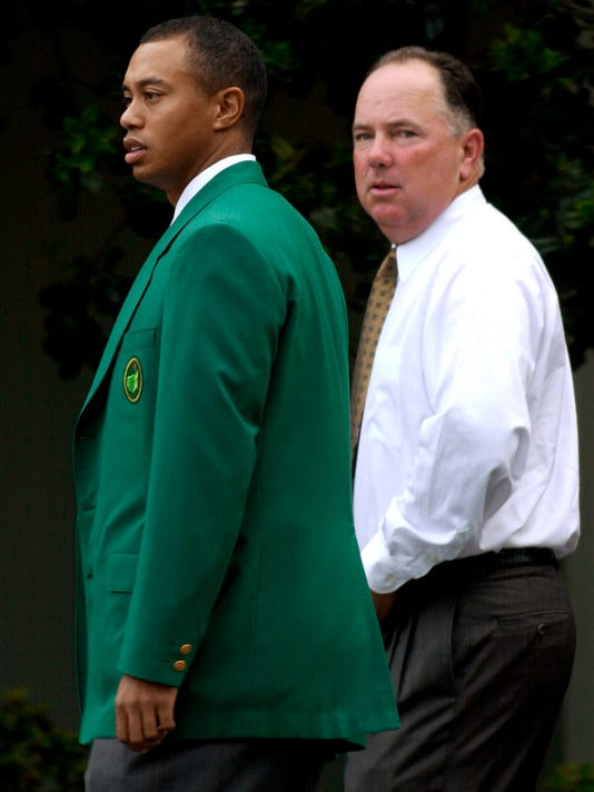FILE - In this Tuesday, April 9, 2002, file photo, Defending Masters Champion Tiger Woods, left, and 1998 Masters Champion Mark O'Meara, right, arrive at the Augusta National Golf Club for the annual Champions dinner at the 2002 Masters, in Augusta, Ga. Of all the traditions unlike any other at the Masters, the Tuesday, April 4, 2017, night champions' dinner rates as high as any. (AP Photo/Dave Martin, File)