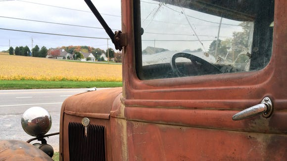The truck marks the farm stand.