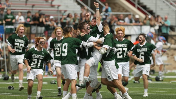 Pleasantville goalie (center) Jack Fitzgerald  is mobbed