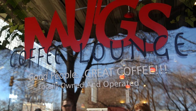 Mugs Coffee Lounge at 261 S. College Ave. is a locally owned and operated business in downtown Fort Collins. The store front is shown Thursday Feb. 5, 2009.