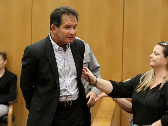 Peter Martorana is taken into custody in Superior Court Judge Rochelle Gizinski's courtroom in Toms River Friday, August 11, 2017, after deciding that instead of being sentenced  for money laundering, he wanted to withdraw his earlier plea.  He had pled guilty to money laundering in what authorities allege was the theft of some $1 million from more than a dozen elderly victims.