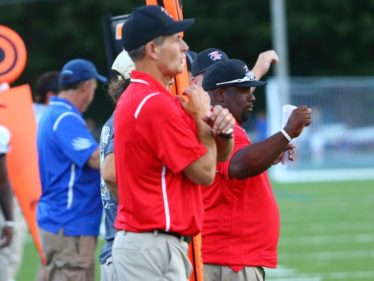 Raleigh Egypt Head Coach Major Wright, center, and