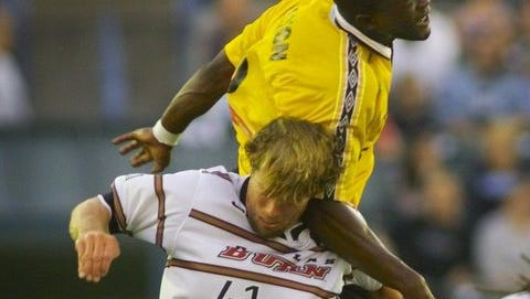 Mali Walton goes up and over Dallas Burn's Ted Eck in a 1999 U.S. Open Cup quarterfinal match. Walton and former Rhinos forward Darren Tilley will be inducted into the team's Hall of Fame at Saturday's home match.