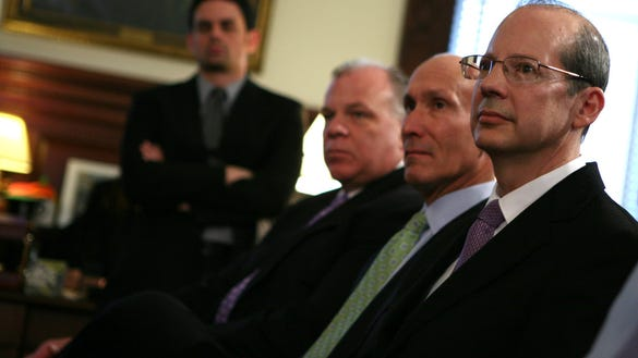 Chief Justice Stuart Rabner observes at the news conference where Gov. Chris Christie announced his renomination to the Supreme Court. Seated with Rabner are Superior Court Judge Lee Solomon, who was also nominated to the state's highest court, and Senate President Stephen Sweeney. (Tim Larsen/Governor's Office)