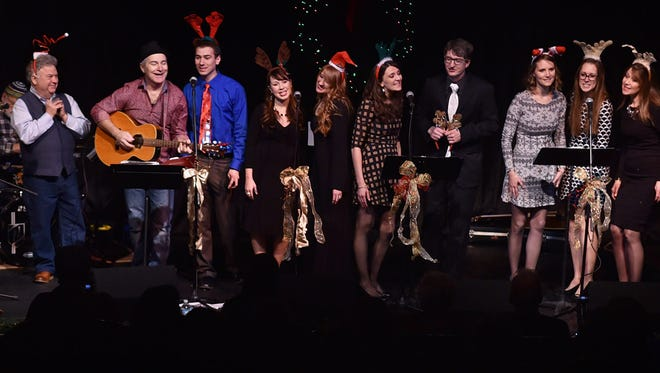 The extended musical Hagen family on stage at Third Avenue Playhouse during a past Hagen Family Christmas show. The annual holiday concert returns to TAP on Dec. 16.