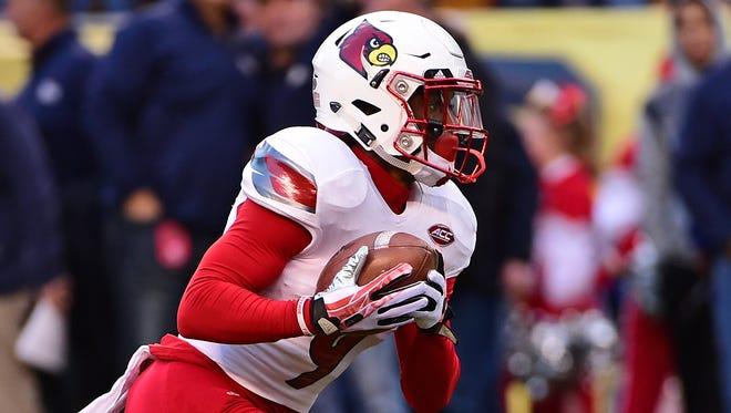 Louisville wide receiver Traveon Samuel (9) runs the ball during a NCAA football game against Pittsburgh, Saturday, Nov. 21, 2015 in Pittsburgh. (AP Photo/Fred Vuich)