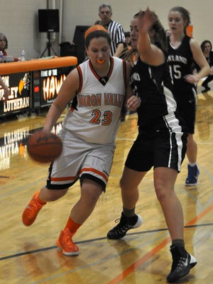 Huron Valley Lutheran's Julie St. John drives to the basket during a game earlier this season.