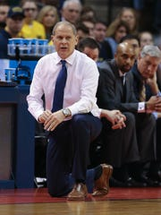 Michigan Wolverines head coach John Beilein on the bench against Oklahoma State during the first half of U-M's 92-91 win Friday, March 17, 2017 at Bankers Life Fieldhouse in Indianapolis in the NCAA tournament.