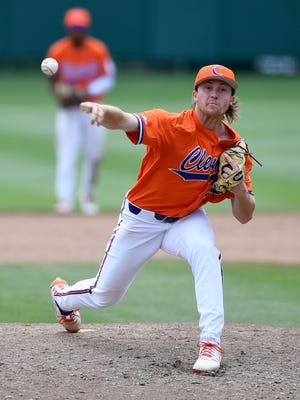 Clemson pitcher Ryan Miller (35) pitches against St. John's during the bottom of the third inning of the NCAA Clemson Regional at Doug Kingsmore Stadium in Clemson Sunday, June 3, 2018.