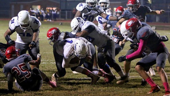 Patrick Johnston/Times Record News City View's Tamell Monroe (center) is stopped by the Holliday defense while diving for extra yardage Friday night in Holliday. The Mustangs' attempt to score off an interception in the final minute of the first half was ended with two false start penalties.