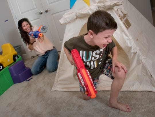 Linzie Smith, battles it out with Nerf guns with Liam,