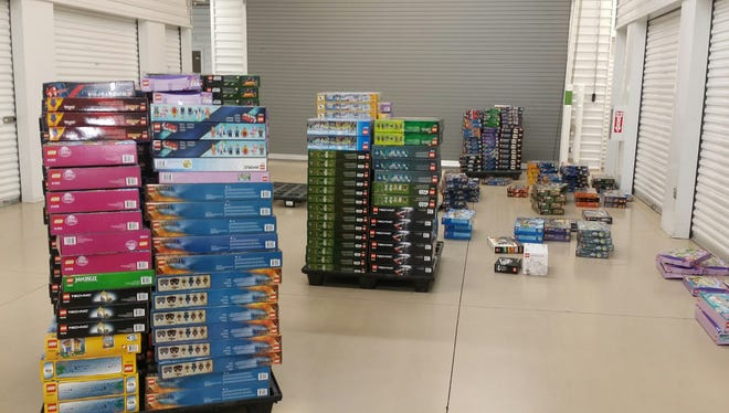 """Phoenix police say they have arrested four people in a retail-theft scheme involving at least $40,000 in Legos stolen from various Toys """"R"""" Us stores, and they recovered a total of $200,000 in Lego play sets from one of the suspect's homes."""