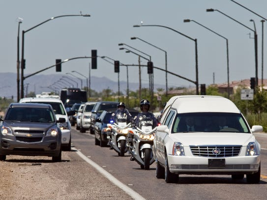 Motorists pull off the road as the funeral procession