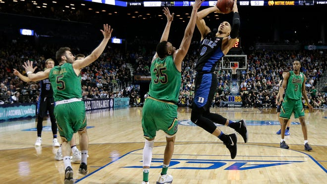 Duke forward Jayson Tatum (0) puts up a shot against Notre Dame forward Bonzie Colson (35) in the second half of an NCAA college basketball game during the championship game of the Atlantic Coast Conference tournament, Saturday, March 11, 2017, in New York. (AP Photo/Julie Jacobson)
