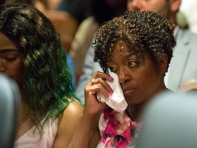 Chavella WIlliams, Ariana Williams' mother, wipes a