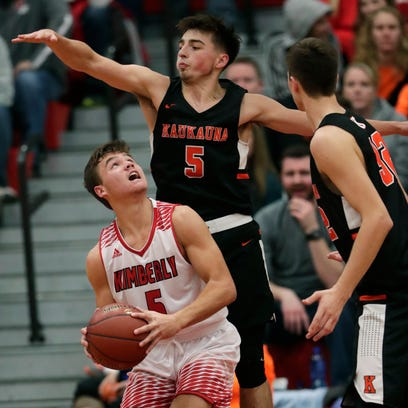 Kimberly's Alec Rosner (left) looks to put up a shot