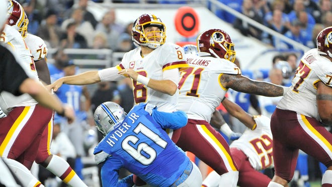 The Lions' Kerry Hyder pressures Washington quarterback Kirk Cousins but not before he gets the ball off in the second quarter.