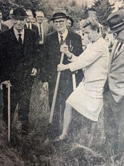 Betty Tyson breaks ground on the Black Mountain Library building in a May 8, 1967 ceremony. Tyson is surrounded by mayor Dick Stone, Dr. William Morgan, Dr. W.D. Weatherford and Mrs. Culver Smith, Friends of the Library president.