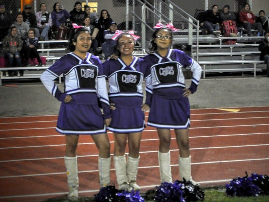 Mescalero cheerleaders motivate the Chiefs from the