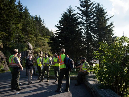 National Parks Service employees and volunteers gather