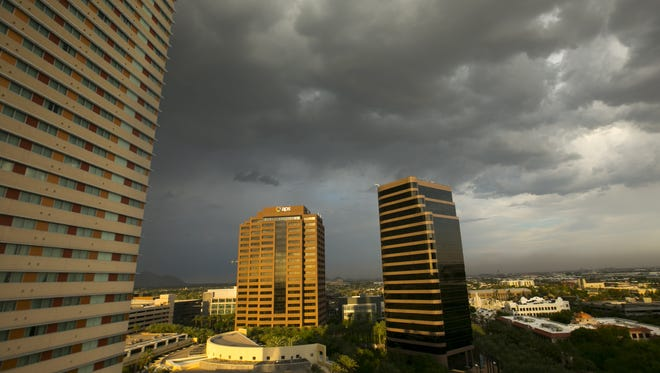 Storm clouds loom over downtown Phoenix on Wednesday evening, Aug. 24, 2016.