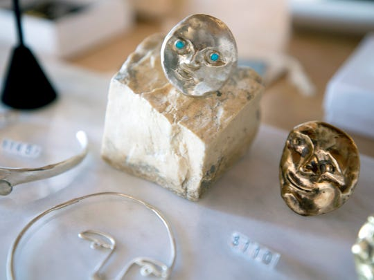 Noons has a carefully curated selection of clothing, housewares and jewelry like these moon-faced silver rings.