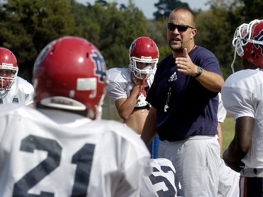Former North DeSoto head coach Jerry Byrd talks his team through a play during practice at the school in the fall of 2007.