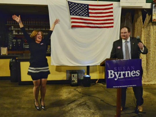 Susan Byrnes leaps as her campaign manager, Joel Ogel, announces her win in the York County Commissioners race. John Pavoncello photo.