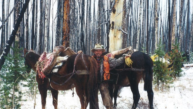 Dave Hovde gets ready to pack out an elk after a hunting trip.