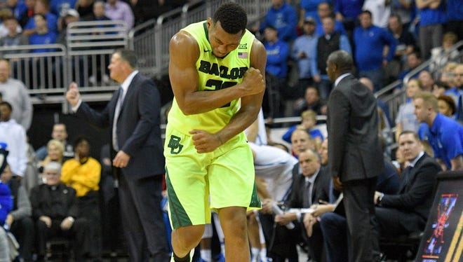 Baylor Bears guard King McClure (22) celebrates after a score during the second half against the Creighton Bluejays at Sprint Center.