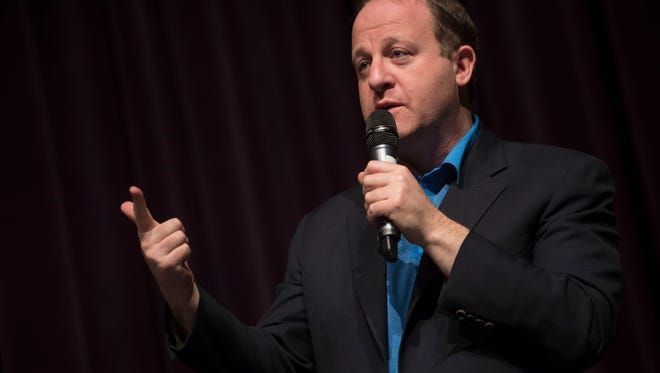Colorado gubernatorial candidate Jared Polis answers a question posed by moderators in front of an assembled audience on Saturday, March 3, 2018, at Fossil Ridge High School in Fort Collins, Colo.