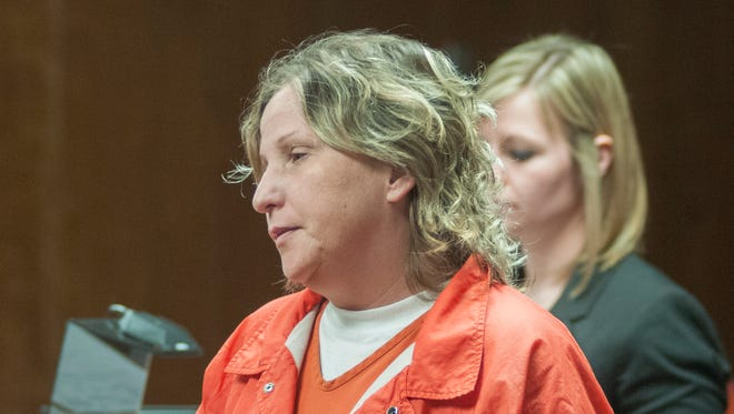 Susan Genevieve Miller stands in front of District Judge Michael Hulewicz Wednesday, March 30 for a probable cause hearing at the courthouse in Marine City.