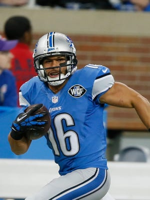 Lions WR Lance Moore picks up a first down in the third quarter against the Bears on Sunday.