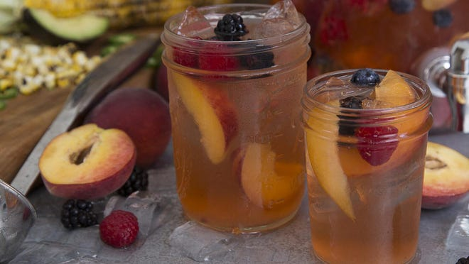 This peach sangria includes peach preserves, schnapps, riesling, sparkling wine, vodka and ginger ale.