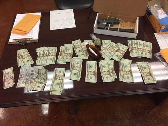 Scott police recovered narcotics, a gun and a large amount of cash from Davonn Warren's car, according to the Scott Police Department