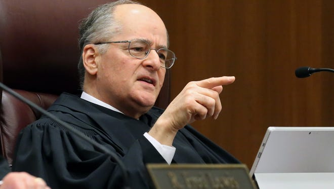 Florida Supreme Court justice Charles Canady asks a question of a presenter on congressional district maps Tuesday, Nov. 10, 2015, in Tallahassee, Fla. Florida's highest court is being asked to resolve a long-running legal battle over Florida's political landscape. (AP Photo/Steve Cannon)