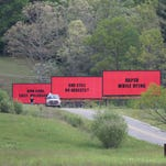 "Jarring messages appear along North Fork Left Fork in Black Mountain last week as crews began filming ""Three Billboards Outside Ebbing, Missouri,"" directed by Martin McDonagh."