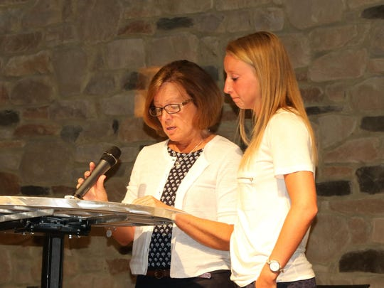 Tammy Jump, of Union, shared the story of her granddaughter Bella at the Heroin Town Hall in Florence. Her daughter Abby Jump, right, came on stage to support her.