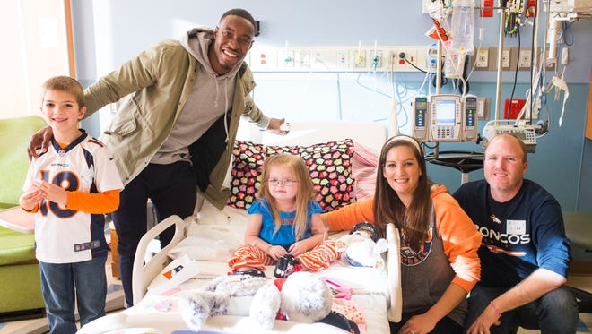Broncos CB Taurean Nixon, second from left, spends many of his Sundays with patients at the Rocky Mountain Hospital for Children. He visits Gavin, left, Caroline and parents Anna and Andy Pakiz.