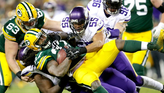 Green Bay Packers running back Eddie Lacy is tackled for a loss in the second quarter against the Minnesota Vikings.