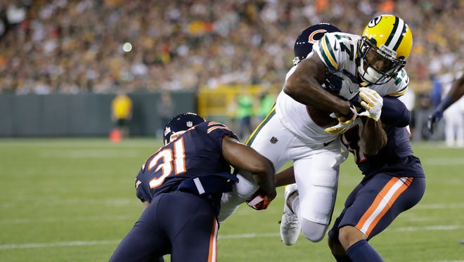 Green Bay Packers wide receiver Davante Adams scores a touchdown in the first half on Thursday against the Bears.