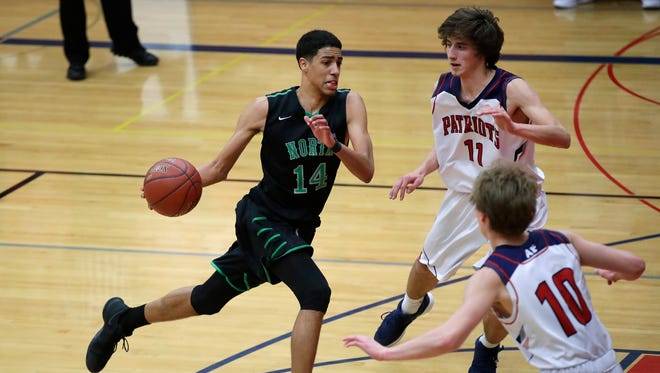 Oshkosh North High School's Tyrese Haliburton tries to get past the Appleton East High School defense Tuesday, Jan. 30, 2018, in Appleton, Wis.Danny Damiani/USA TODAY NETWORK-Wisconsin